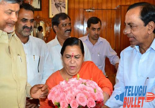 uma bharti giving kcr bouquet flower chandrababu affects council meeting