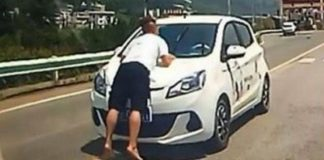Wife Drives Five Kilometers With Her Husband On Car Bonnet